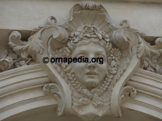 French stone carved versailles key female head