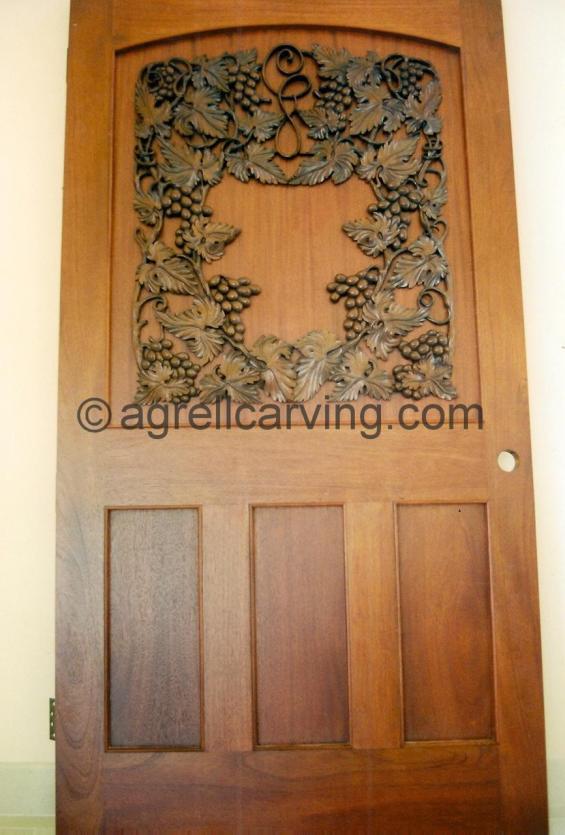 Door with grape vine